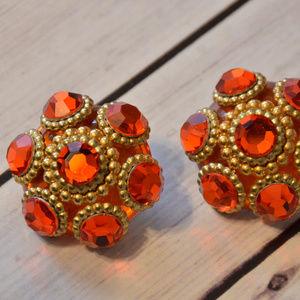 huge 1980's orange rhinestone gold clip earrings